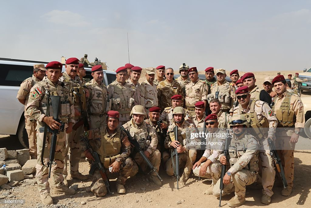 Defense Minister of Iraq Khaled al-Obaidi (C) poses for a photograph with Iraqi soldiers during his visit to Ninova Joint Operations Commandership to examine the Mosul rescue operation from Daesh in Mosul's Mahmur district, Iraq on June 21, 2016.
