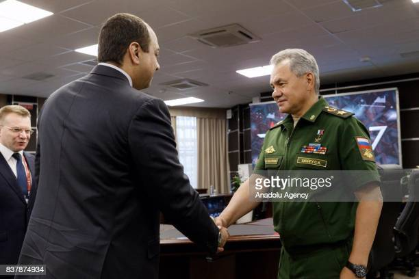 Defense Minister of Russia Sergey Shoygu shakes hands with Minister of State for Defense of Qatar Khalid bin Mohammad Al Attiyah after their meeting...