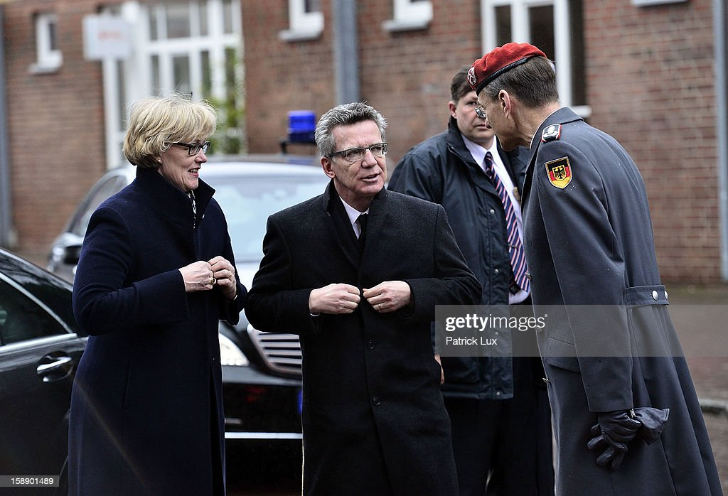 Defense Minister <a gi-track='captionPersonalityLinkClicked' href=/galleries/search?phrase=Thomas+de+Maiziere&family=editorial&specificpeople=618845 ng-click='$event.stopPropagation()'>Thomas de Maiziere</a> (CDU, C) and his wife Martina are greeted by Colonel Hubertus von Rohr, head of the protocol at the Defense ministy, as they arrive at a memorial service for former German Defence Minister Peter Struck on January 3, 2013 in Uelzen, Germany. Struck was a leading member of the German Social Democrats (SPD) and died in December following a heart attack.
