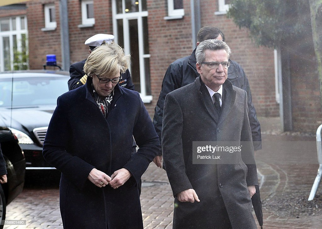 Defense Minister <a gi-track='captionPersonalityLinkClicked' href=/galleries/search?phrase=Thomas+de+Maiziere&family=editorial&specificpeople=618845 ng-click='$event.stopPropagation()'>Thomas de Maiziere</a> (CDU) and his wife Martina arrive at a memorial service for former German Defence Minister Peter Struck on January 3, 2013 in Uelzen, Germany. Struck was a leading member of the German Social Democrats (SPD) and died in December following a heart attack.