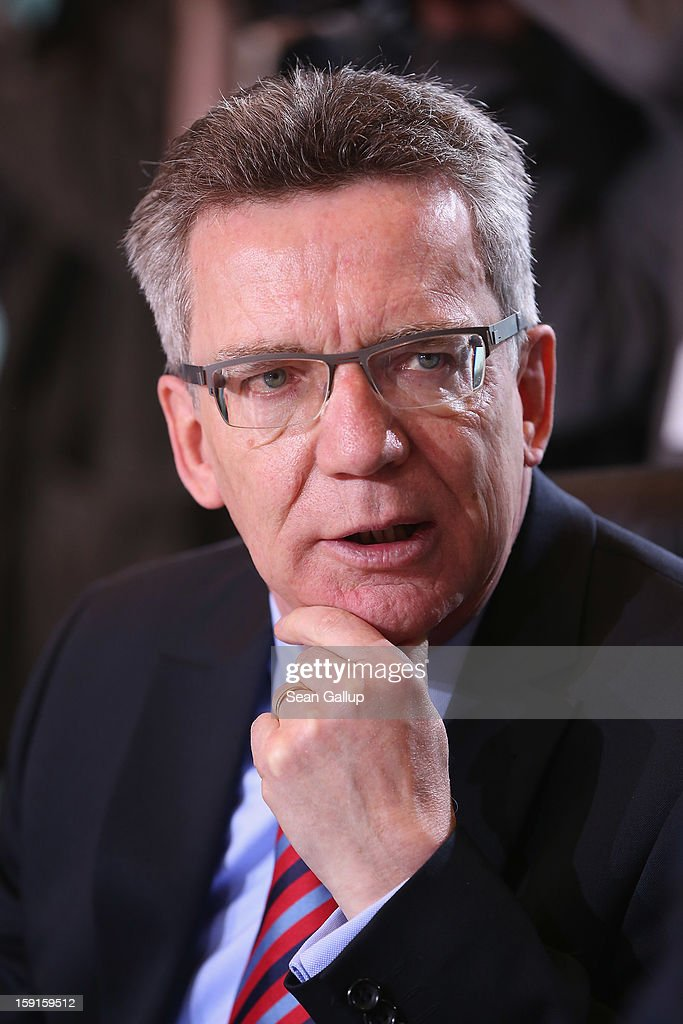 Defense Minister <a gi-track='captionPersonalityLinkClicked' href=/galleries/search?phrase=Thomas+de+Maiziere&family=editorial&specificpeople=618845 ng-click='$event.stopPropagation()'>Thomas de Maiziere</a> arrives for the weekly German government cabinet meeting on January 9, 2013 in Berlin, Germany. High on the morning's agenda was the latest government culture and education report.