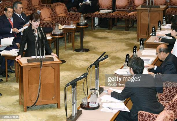 Defense Minister Tomomi Inada attends an upper house budget committee in Tokyo on March 15 a day after she retracted her earlier remarks that she has...