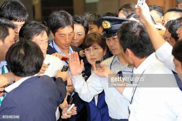 Defense Minister Tomomi Inada is surrounded by media reporters as she leaves the Defense Ministry on July 27 2017 in Tokyo Japan Inada has been...