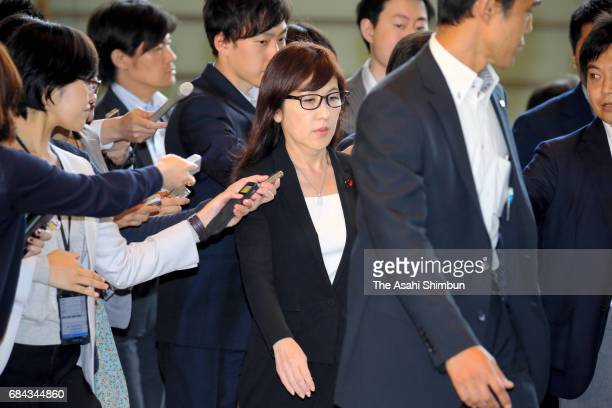Defense Minister Tomomi Inada is surrounded by media reporters on arrival at Prime Minister Shinzo Abe's official residence after North Korea...