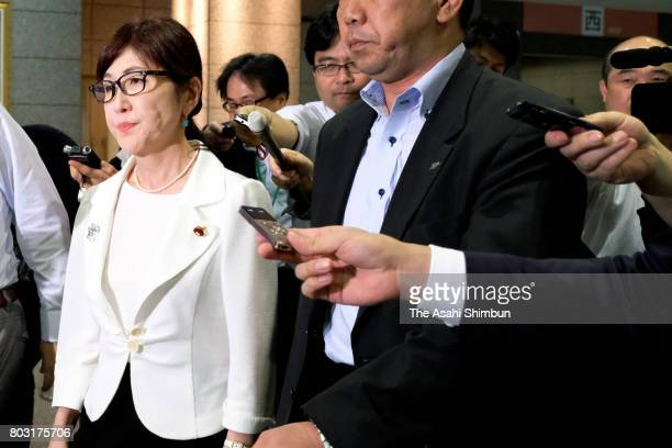 Defense Minister Tomomi Inada leaves the Defense Ministry as reporters try to question her about a comment made during a campaign rally on June 28...