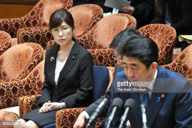 Defense Minister Tomomi Inada listens to Prime Minister Shinzo Abe during the Lower House Budget Committee on July 24 2017 in Tokyo Japan Abe...