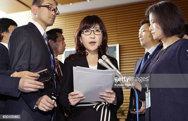 Defense Minister Tomomi Inada meets with reporters at the prime minister's office in Tokyo on Dec 22 when the government adopted guidelines in...