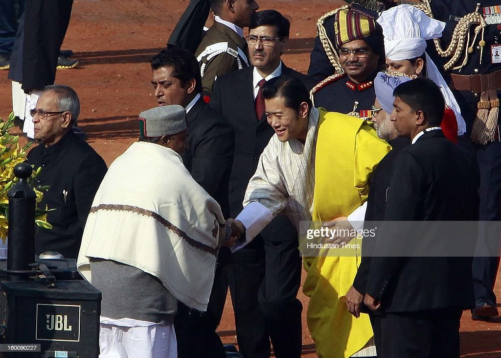 Defense Mnister AK Antony receives the chief guest King of Bhutan, Jigme Khesar Namgyel Wangchuck during the 64th Republic Day parade celebration at Raj path on January 26, 2013 in New Delhi, India. India marked its Republic Day with celebrations held under heavy security, especially in New Delhi where large areas were sealed off for an annual parade of military hardware.