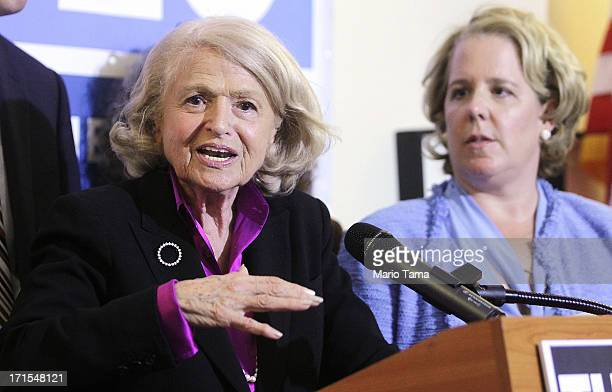 Defense of Marriage Act plaintiff Edith 'Edie' Windsor speaks with her lead attorney Roberta Kaplan at a press conference in Manhattan following the...