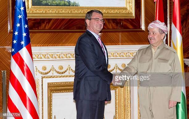 S Defense Secretary Ash Carter and Iraqi Kurdistan Regional President Massoud Barzani shake hands at the White House on July 24 2015 in Irbil Iraq...