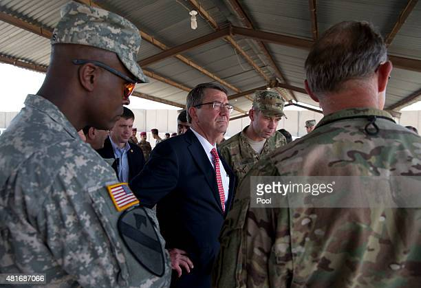 S Defense Secretary Ash Carter stands with Col Otto Liller commander 1st Special Forces Group as he observes Iraqi Counter Terrorism Service forces...