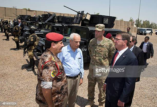 S Defense Secretary Ash Carter stands with Col Otto Liller commander1st Special Forces Group as he is greeted by Iraqi Major General Falah al...