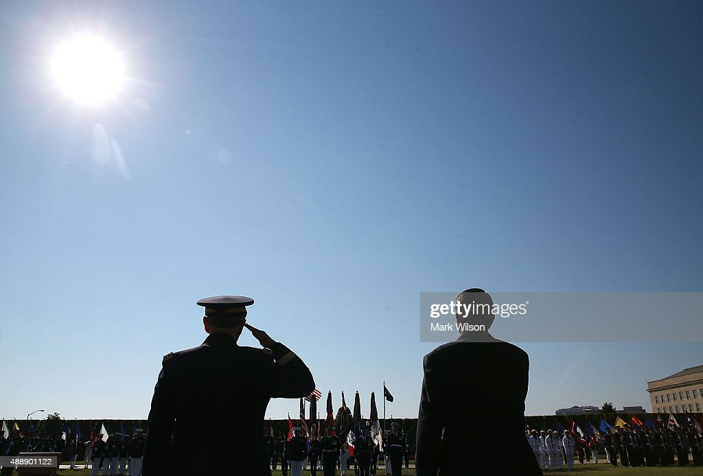 U.S. Defense Secretary Ashton Carter (R) and Chairman of the Joint Chiefs of Staff Gen. Martin Dempsey participate in the Defense Department's National POW/MIA Recognition Day Ceremony on the Pentagon River Terrace Parade Field September 18, 2015 in Arlington, Virginia. The annual event honors prisoners of war, those missing in action and their families, and highlights the government's continued work to account for them.