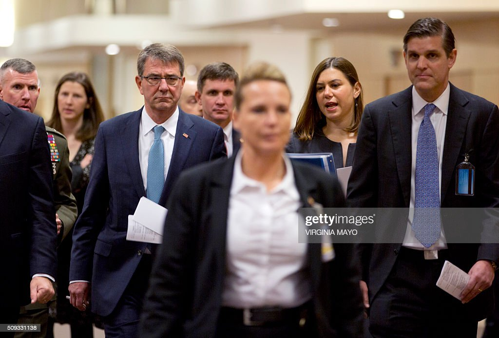 US Defense Secretary Ashton Carter (L) arrives for a bilateral meeting at NATO headquarters in Brussels on February 10, 2016. NATO defense ministers convene a two-day meeting to discuss current defence issues and whether the Alliance should take a more direct role in dealing with its gravest migrant crisis since WWII. / AFP / POOL / Virginia Mayo
