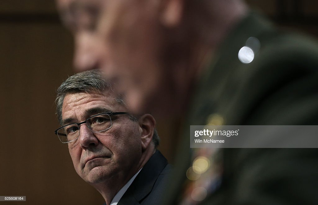 S Defense Secretary Ashton Carter listens as Chairman of the Joint Chiefs of Staff Gen Joseph Dunford Jr testifies before the Senate Armed Services...