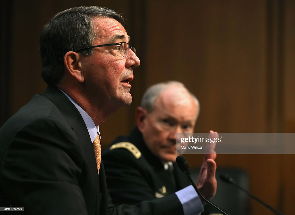Defense Secretary <a gi-track='captionPersonalityLinkClicked' href=/galleries/search?phrase=Ashton+Carter&family=editorial&specificpeople=956792 ng-click='$event.stopPropagation()'>Ashton Carter</a> (L) testifies while Chairman of the Joint Chiefs of Staff Army Gen. <a gi-track='captionPersonalityLinkClicked' href=/galleries/search?phrase=Martin+Dempsey&family=editorial&specificpeople=2116621 ng-click='$event.stopPropagation()'>Martin Dempsey</a> listens during a Senate Armed Services Committee hearing on Capitol Hill March 3, 2015 in Washington, DC. The committee is hearing testimony global security issues and President Obama's FY2016 Department of Defense budget request.