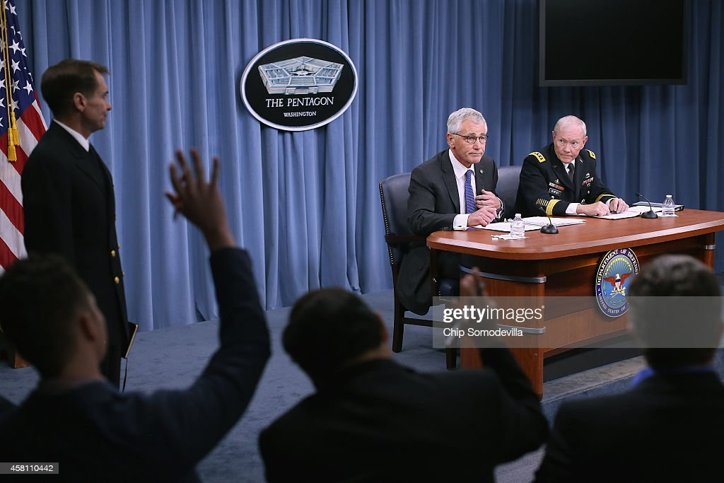U.S. Defense Secretary Chuck Hagel and Chairman of the Joint Chiefs of Staff Gen. Martin Dempsey hold a news conference at the Pentagon October 30, 2014 in Arlington, Virginia. Hagel and Dempsey fielded questions about the terrorist group ISIL, U.S. troop deployment to West Africa to counter Ebola and the continued draw-down of troops in Afghanistan.