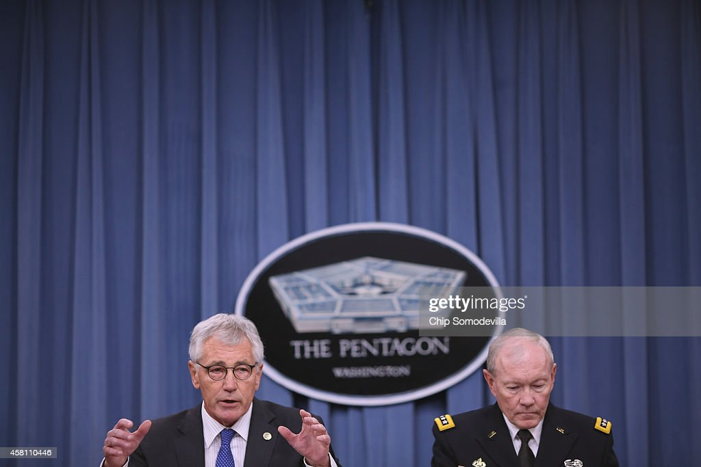 U.S. Defense Secretary <a gi-track='captionPersonalityLinkClicked' href=/galleries/search?phrase=Chuck+Hagel&family=editorial&specificpeople=504963 ng-click='$event.stopPropagation()'>Chuck Hagel</a> (L) and Chairman of the Joint Chiefs of Staff Gen. <a gi-track='captionPersonalityLinkClicked' href=/galleries/search?phrase=Martin+Dempsey&family=editorial&specificpeople=2116621 ng-click='$event.stopPropagation()'>Martin Dempsey</a> hold a news conference at the Pentagon October 30, 2014 in Arlington, Virginia. Hagel and Dempsey fielded questions about the terrorist group ISIL, U.S. troop deployment to West Africa to counter Ebola and the continued draw-down of troops in Afghanistan.