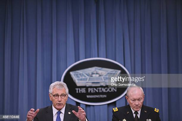 S Defense Secretary Chuck Hagel and Chairman of the Joint Chiefs of Staff Gen Martin Dempsey hold a news conference at the Pentagon October 30 2014...