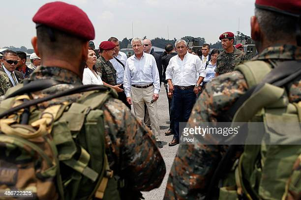 S Defense Secretary Chuck Hagel and Guatemala's President Otto Perez Molina observe a military exercise before Hagel's departure on April 25 2014 in...