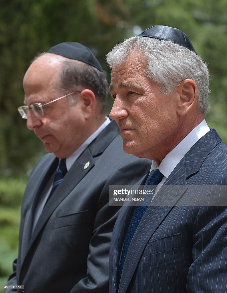 US Defense Secretary Chuck Hagel (R) and Israeli Defense Minister Moshe Ya'alon pay their repsects at the tomb of assassinated Israeli prime minister Yitzhak Rabin on May 16, 2014, at the Mount Herzl national cemetery in Jerusalem. Israeli Prime Minister Benjamin Netanyahu told Hagel today that world powers must deny Iran any possibility of developing a nuclear weapon as the search for a deal intensifies.
