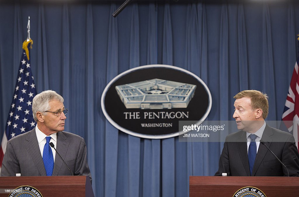 US Defense Secretary Chuck Hagel (L) and New Zealand Defense Minister Jonathan Coleman (R) speak during a press conference at the Pentagon in Washington, DC, October 28, 2013. AFP PHOTO / Jim WATSON
