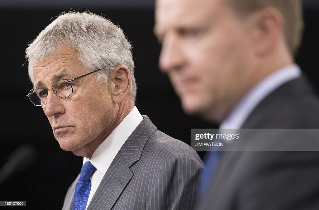 US Defense Secretary Chuck Hagel (L) and New Zealand Defense Minister Jonathan Coleman speak during a press conference at the Pentagon in Washington, DC, October 28, 2013. AFP PHOTO / Jim WATSON