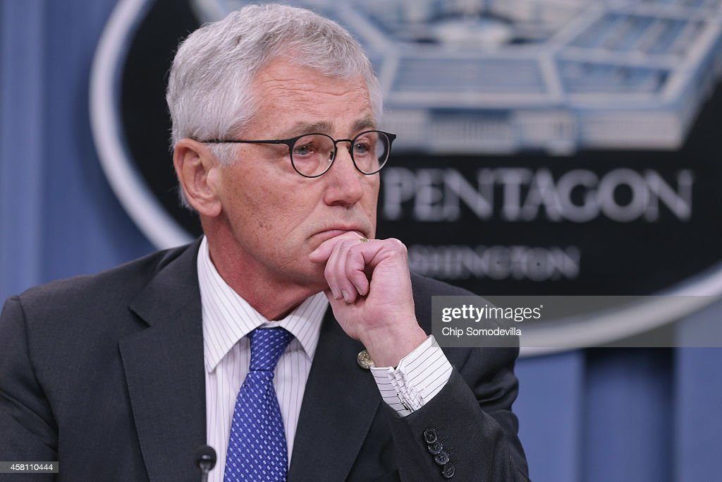 U.S. Defense Secretary <a gi-track='captionPersonalityLinkClicked' href=/galleries/search?phrase=Chuck+Hagel&family=editorial&specificpeople=504963 ng-click='$event.stopPropagation()'>Chuck Hagel</a> answers reporters' questions during a news conference at the Pentagon October 30, 2014 in Arlington, Virginia. Hagel and Chairman of the Joint Chiefs of Staff Gen. Martin Dempsey fielded questions about the terrorist group ISIL, U.S. troop deployment to West Africa to counter Ebola and the continued draw-down of troops in Afghanistan.