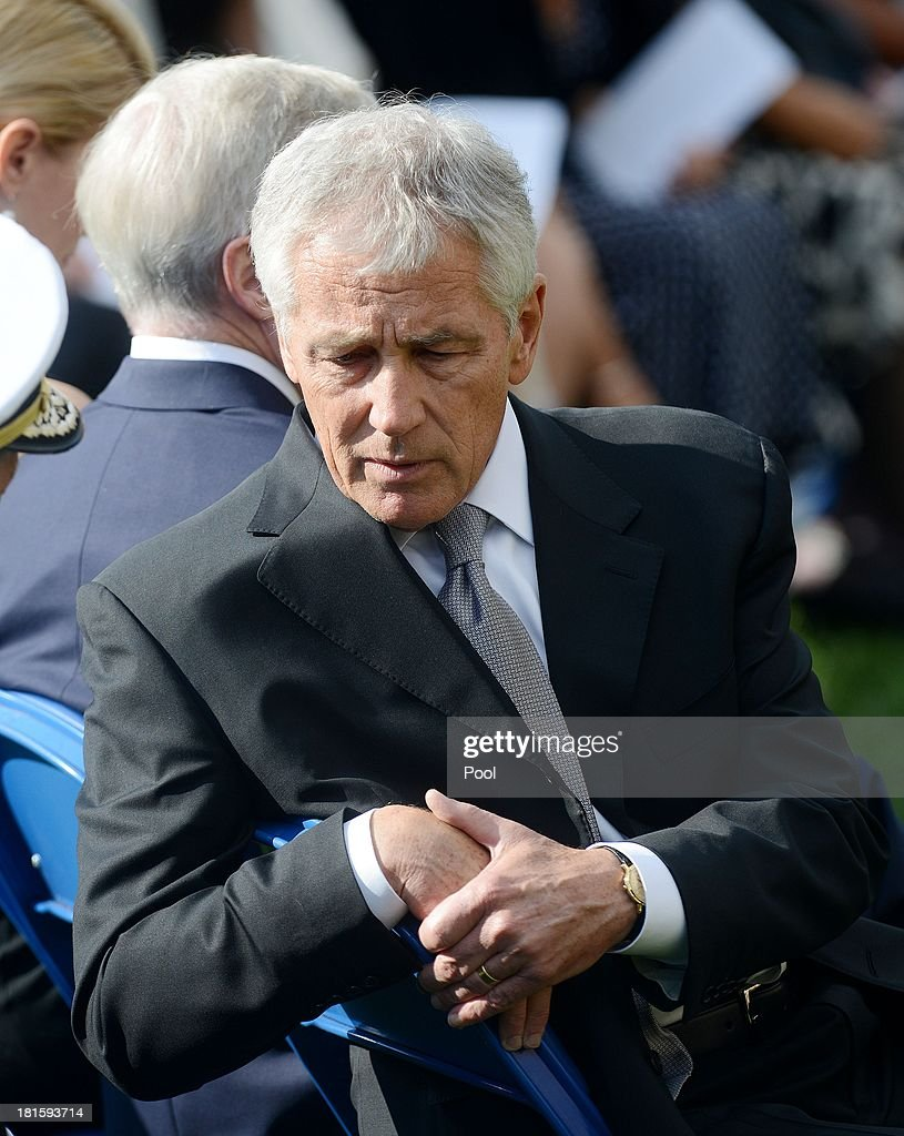Defense Secretary Chuck Hagel attends a memorial for the victims of the Washington Navy Yard shooting September 22, 2013 at the Marine Barracks in Washington, D.C. President Obama and the first lady visited with families of the victims.