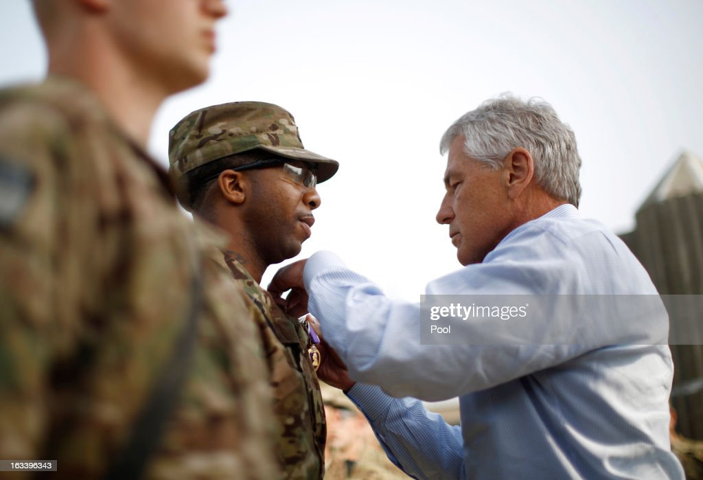 US Defense Secretary <a gi-track='captionPersonalityLinkClicked' href=/galleries/search?phrase=Chuck+Hagel&family=editorial&specificpeople=504963 ng-click='$event.stopPropagation()'>Chuck Hagel</a> awards a Purple Heart medal to Sergeant Jeremyah Williams (C) of the 426 Brigade Support Battalion at Jalalabad Airfield on March 9, 2013 near the southeast of Jalalabad city, Afghanistan. Hagel is on his first official trip since being sworn in as US President Obama's Defense Secretary.