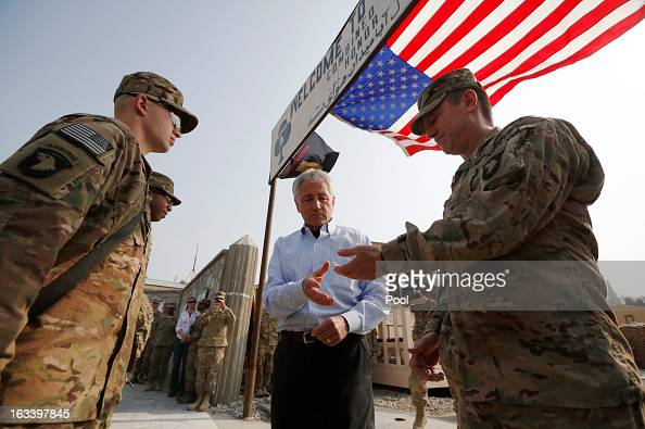 Defense Secretary Chuck Hagel awards the Purple Heart medal to Army Private Harry Hikes and Sergeant Jeremyah Williams of the 426 Brigade Support...