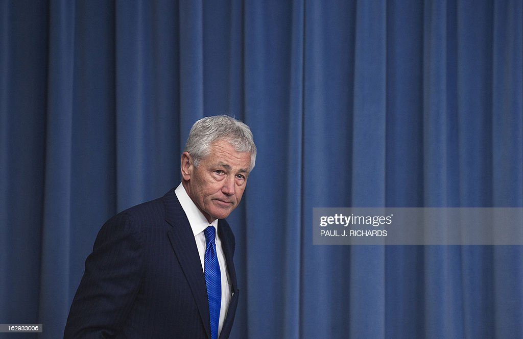 US Defense Secretary Chuck Hagel enters the Pentagon briefing room to deliver remarks on the impending sequestration on March 1, 2013. AFP PHOTO/Paul J. Richards