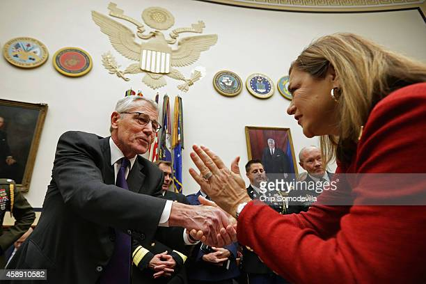 S Defense Secretary Chuck Hagel is greeted by House Armed Services Committee member Rep Loretta Sanchez before a committee hearing about the ongoing...