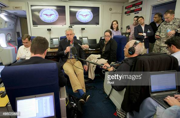 S Defense Secretary Chuck Hagel is seen aboard a US Military Aircraft before speaking to members of the media during his flight on June 1 2014 Hagel...