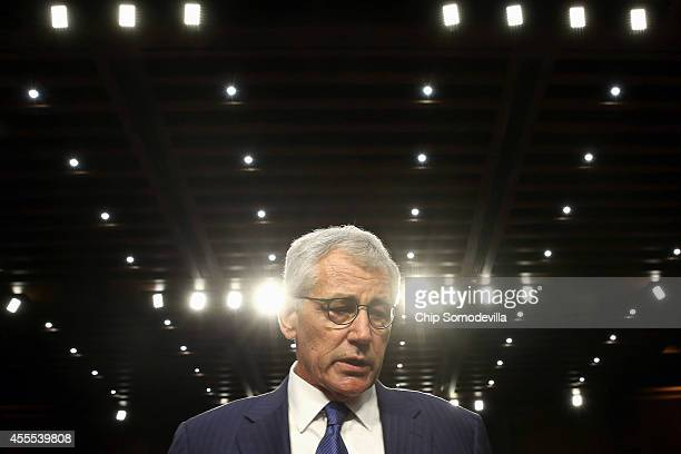 S Defense Secretary Chuck Hagel leaves after testifying before the Senate Armed Services Committee in the Hart Senate Office Building on Capitol Hill...