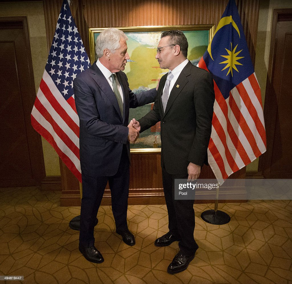 U.S. Defense Secretary <a gi-track='captionPersonalityLinkClicked' href=/galleries/search?phrase=Chuck+Hagel&family=editorial&specificpeople=504963 ng-click='$event.stopPropagation()'>Chuck Hagel</a>, left, meets with Malaysian Defense Minister <a gi-track='captionPersonalityLinkClicked' href=/galleries/search?phrase=Hishammuddin+Hussein&family=editorial&specificpeople=774002 ng-click='$event.stopPropagation()'>Hishammuddin Hussein</a> on May 31, 2014 in Singapore. Hagel warned an international security conference Saturday that the U.S. 'will not look the other way' when nations such as China try to restrict navigation or ignore international rules and standards.
