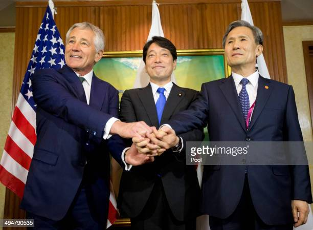 S Defense Secretary Chuck Hagel meets with South Korean Defense Minister Kim Kwanjin and Japanese Defense Minister Itsunori Onodera May 31 2014 in...