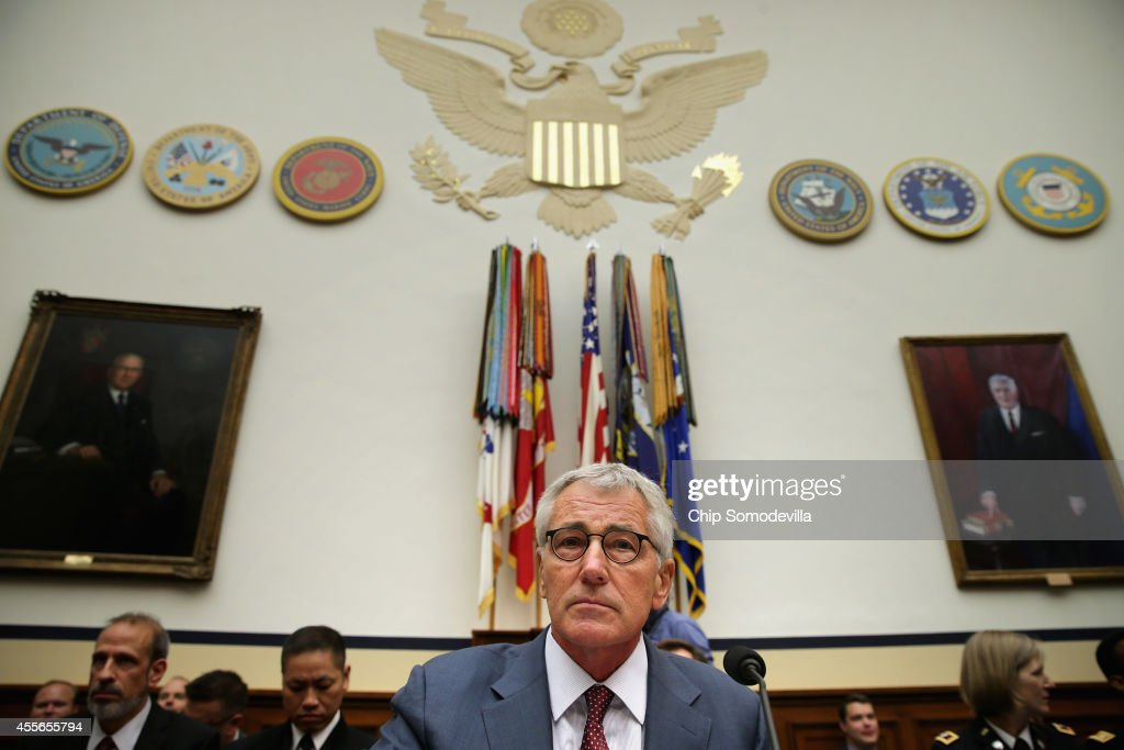 Defense Secretary Chuck Hagel prepares to testify before the House Armed Services Committee about the ongoing threat from the Islamic State of Iraq...