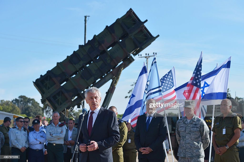 U.S. Defense Secretary <a gi-track='captionPersonalityLinkClicked' href=/galleries/search?phrase=Chuck+Hagel&family=editorial&specificpeople=504963 ng-click='$event.stopPropagation()'>Chuck Hagel</a> (C) stands in front of a Patriot missile battery while speaking to U.S. and Israeli troops after viewing Juniper Cobra 14 military exercise at Hatzor Israeli Air Force Base on May 15, 2014 near kibbutz Hatzor, Israel. Hagel is touring the region to focus on Iran's nuclear program and the Syrian civil war.
