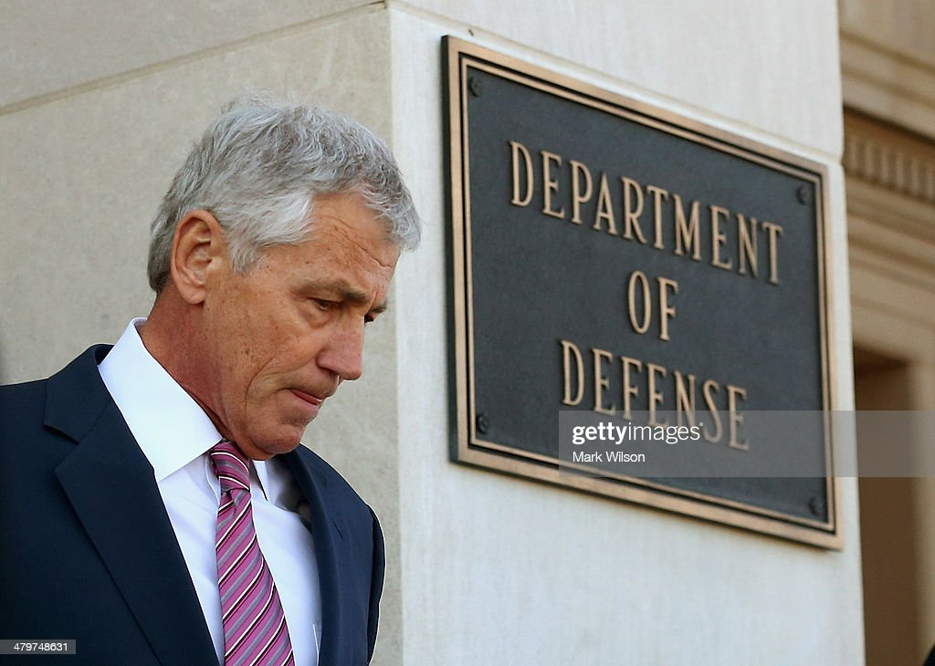 US Defense Secretary <a gi-track='captionPersonalityLinkClicked' href=/galleries/search?phrase=Chuck+Hagel&family=editorial&specificpeople=504963 ng-click='$event.stopPropagation()'>Chuck Hagel</a> walks up to greet Saudi Arabia's Deputy Minister of Defense Prince Salman bin Sultan, on March 20, 2014 in Arlington, Virginia. Secretary Hagel hosted the honor cordon for the visiting Deputy Minister of Defense.