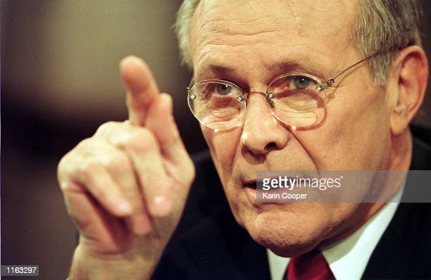 Defense Secretary Donald Rumsfeld talks before his appearance on the CBS talk show 'Face the Nation' June 23 2001 in Washington DC