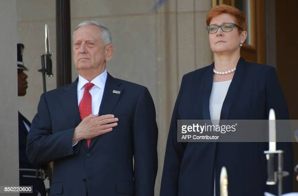 US Defense Secretary James Mattis and Australian Defense Minister Marise Payne listen to the national anthems during a welcome ceremony at the...