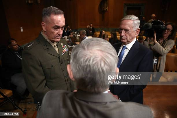 S Defense Secretary James Mattis and Joint Chiefs of Staff Chairman Joseph Dunford confer with Sen Jack Reed prior to their testimony before the...