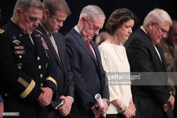S Defense Secretary James Mattis bows his head in prayer before delivering the keynote address during the Association of the United States Army's...