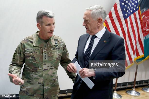 S Defense Secretary James Mattis chats with US Army General John Nicholson commander of US Forces Afghanistan after a news conference at Resolute...