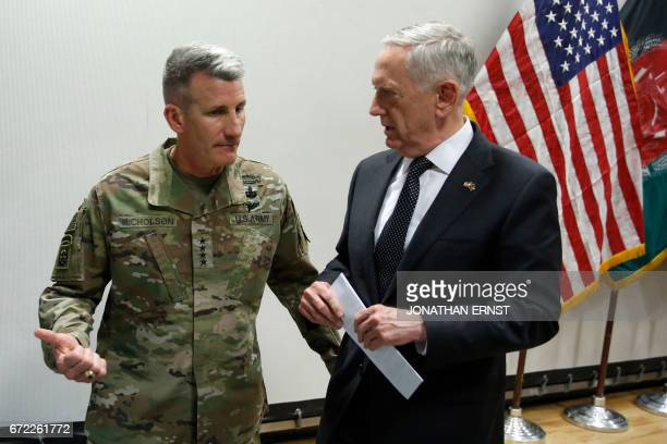 US Defense Secretary James Mattis chats with US Army General John Nicholson commander of US forces in Afghanistan after a news conference at Resolute...