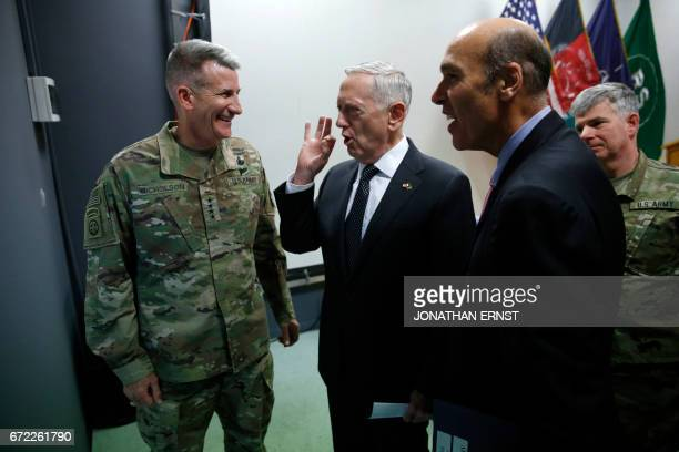 US Defense Secretary James Mattis chats with US Army General John Nicholson commander of US forces in Afghanistan next to US Embassy Charge...