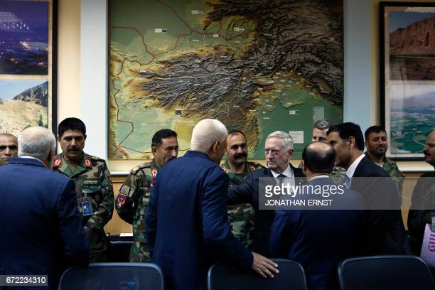 US Defense Secretary James Mattis consoles outgoing Afghanistan Defense Minister Abdullah Habibi who resigned his post earlier in the day in the wake...
