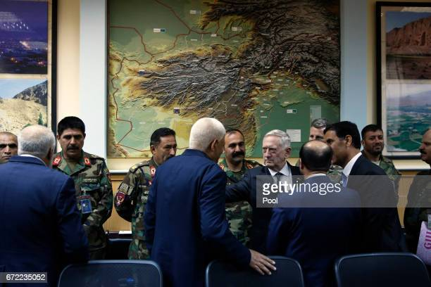 S Defense Secretary James Mattis consoles outgoing Afghanistan Defense Minister Abdullah Habibi who resigned his post earlier in the day in the wake...