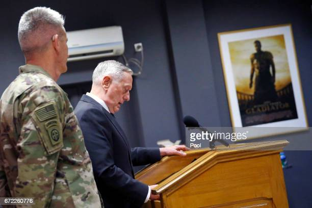 S Defense Secretary James Mattis flanked by US Army General John Nicholson commander of US Forces Afghanistan holds a news conference in a room...